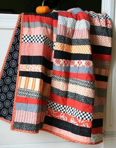 Fall Quilt - Love the colors and how stylish a simple stripe design can look.