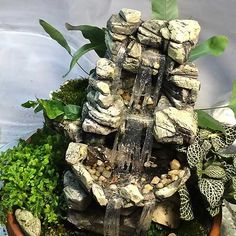 Make your own DIY Miniature Terrarium Waterfall easily by carving styrofoam, painting, and adding a resin water feature made by barb