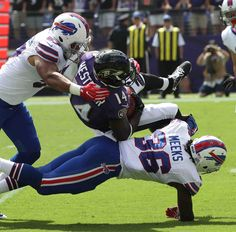 Bills-Ravens:    Monday, September 12, 2016  -   Buffalo Bills defensive back Jonathan Meeks (36) tackles Baltimore's Devin Hester Sr.  -   James P. McCoy / Buffalo News News Sports Photographer James P. McCoy captured outstanding images from the Bills' season-opening loss in Baltimore. Here are our favorites