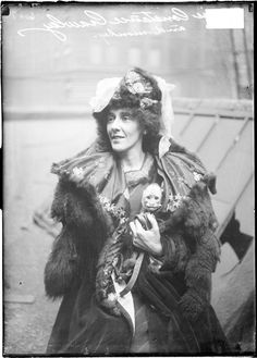 "love this caption - ""Miss Constance Crawley, an actress, holding a monkey inside her coat"" - 1908"