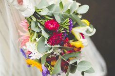 Colourful wedding bouquet. Photography by Amanda Manby
