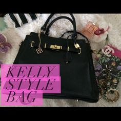 "Black leather handbag Kelly style genuine leather bag, great condition. Comes with dust bag and lock/key. 14"" x 7"" x 11.5"" Bags Satchels"
