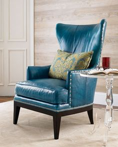 """Donovan"" Wing Chair at Horchow. Top grain blue leather trimmed with pewter nailheads."