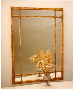 This classic lashed bamboo mirror is available in a variety of leaf and painted finishes. The finish shown here is antique Gold Leaf.