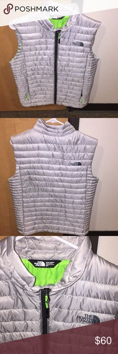NWOT North Face windbreaker (ski) Vest. Insulated Shiny metallic steel grey with lime green inside lining. Very warm and brand new. Great for all things. No marks , stains , etc. Men's Small The North Face Jackets & Coats Vests