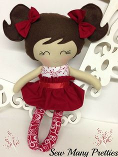 Celebrate Christmas with this special doll!!  This is a 15 inch Doll that is part of the Fancy Pants collection from Sew Many Pretties.  This cutie is handmade from 100% cotton fabrics and wool blend felt for her hair and pigtails. Facial features are hand embroidered. Her pretty red hair bo...