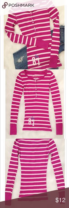 "Aeropostale Waffle Henley Top Aeropostale waffle henley in magenta and soft pink stripes. Top is fitted with a 7 button front opening. Has Aero logo on front, right bottom by the hem. Size xsmall. Measurements approx. 24"" from top of shoulder down to the bottom of the hem, 12"" across the front from underarm to underarm, 25"" sleeves with fitted cuffs. 58% cotton/39% polyester/3% spandex. Aeropostale Tops"