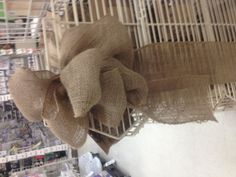 Rustic wedding decor - burlap bow on chair Burlap ribbon and favor bags on Amazon.