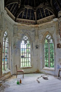Abandoned castle in Belgium (18th century) The chapel in the Gothic Revival style was built in the 19th, the roof is engraved in Latin.