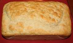 Buttermilk Biscuit Bread (no yeast, no rising and no kneading!)      3 cups all-purpose flour      1 tablespoon baking powder      1/3 cup white sugar      1 teaspoon salt      1 teaspoon baking soda      1 egg, lightly beaten      2 cups buttermilk      1/4 cup butter, melted