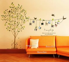 I had this idea for the baby's room (pin up Polaroid's of family members on a clothes line) this is cute too, would go with the tree decals...