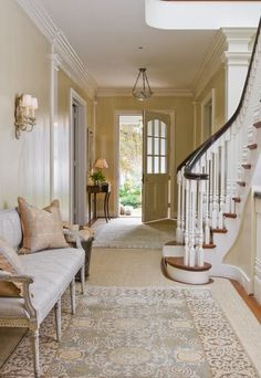 Love the idea of a sculpted sisal carpet with overlays of two rugs...modern, not too formal and yet contemporary.  I then like how they carried the sisal up the stairs as a runner.  Genius