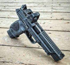 S&W M&P with a nice optic Find our speedloader now…