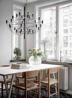 dining - modern chandelier   swedish apartment