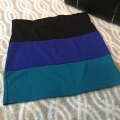 Color block bandage mini skirt Fitted bandage color block Mimi skirt. Perfect condition only worn a few times. Stretchy. Can fit a medium if you want it really tight.  Bundle for more discounts. Boutique Skirts Mini