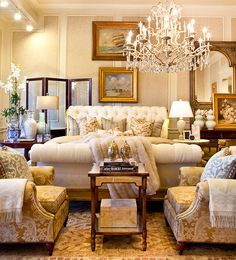 Love how all the gold accents - the picture frames, the throw pillows (which I love, btw), etc. make this room look so warm and inviting.