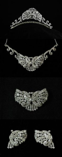 A 1930's parure which assembles into the tiara pictured or similar necklace. Comprises a pair of dress clips with brooch fitting, which combine to form the center butterfly style motif, and the two scrolling sides (necklace or tiara) total weight excess of 10 carats.