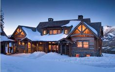 Snow laden log home in Big Sky, Montana