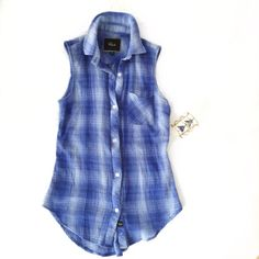 RAILS sleeveless flannel- blue & white Soft sleeveless flannel button made by rails. Blue and white. Flattering on figure. Loose but not baggy. Xs but can fit a small. Rails Tops Button Down Shirts