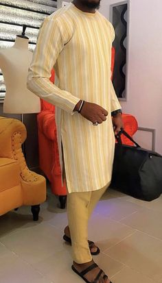 Call, SMS or WhatsApp if you want this style, needs a skilled tailor to hire or you want to expand more on your fashion business. African Wear Styles For Men, African Shirts For Men, African Dresses Men, African Attire For Men, African Clothing For Men, Latest African Fashion Dresses, African Men Fashion, Mens Fashion, Costume Africain