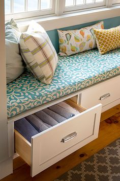 Four drawers under this kitchen window seat provide the perfect place for stashing table linens.