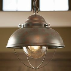 "Give your home a maritime port look and feel with this quaint-looking pendant light.  Measures:  11""W x 12""H.  Available:  Weathered Copper, Espresso."