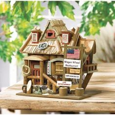 """Wagon Wheel Restaurant Bird House. This busy """"Wagon Wheel Restaurant"""" bird house calls birds to stop in for a meal and rest their weary wings. Wood."""