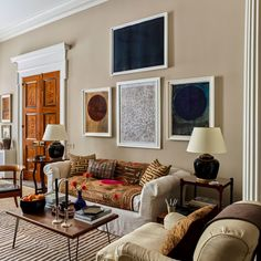art above a sofa, tall windows, stained doors with painted casing Greenwich Village, Custom Canopy, Home Design, Interior Design, Set Design, Interior Architecture, Antique Dining Tables, New York City Apartment, City Apartment Decor