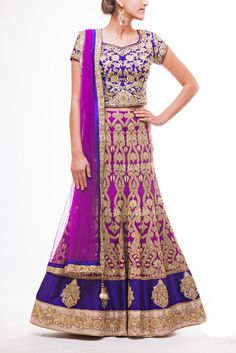 Pure Dupion Silk Plum Lehenga with thick Purple Border and Purple all over embroidered choli paired with plum Net Dupatta.