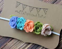 Like my facebook page for 10% off your next order! Just message me after you like my page and I will send you the coupon code. Help me get to 250 likes and I will do a giveaways!   Unique and beautiful felt flower garland headband This headband has 5 felt roses in vineyard and mulberry accented with leaves and attached to a plum skinny elastic headband. Perfect for photo shoots, special occasions, flower girls or every day wear!! All of my felt creations are made just for you and shipped to…