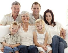 Portrait of family on sofa - royalty-free photo starting at $2.57