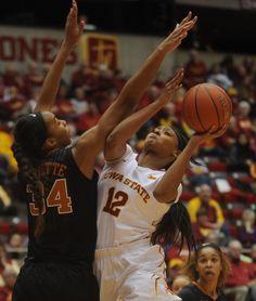 Iowa State's Seanna Johnson takes a shot around Texas' Imani Boyette at Hilton Coliseum on Saturday. Photo by Nirmalendu Majumdar/Ames Tribune   http://amestrib.com/sports/women-s-basketball-texas-turns-late-win-over-cyclones