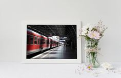 Subject: A Train in Berlin Photographic Print Measurements: Multiple Unframed Sizes Available .  Photographic Paper: Kodak Endura Professional Paper Metallic   How long has it been since you updated the artwork in your home? Are you looking for something different than the mass market art available in big box stores? The majority of my artwork features photography taken during trips around the world over the past 10 years.