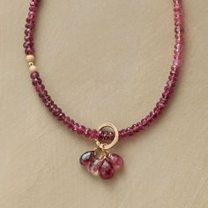 REGALIA NECKLACE -- Thoi Vo regales her necklace with rosiness, from violet garnets to rubies to pink tourmalines. Smooth and textured 14kt gold filled beads spark the strand