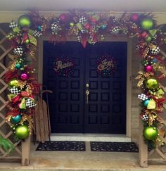 Christmas Decorating- I love the black and white check mixed in with Christmas decor. Different is always good. You could do it with toile or chevron too...#Christmas #Doorway i #funky colors