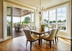 This dining area is bright and opens to a well-appointed covered patio