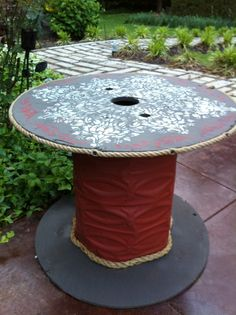 Another spool table made with tin.  This model was a little easier than the first one.  We attached pressed tin to the inner core, painted and stenciled the top, then finished with rope edging.  The whole project took about 2 hours.