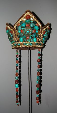 Ceremonial Tibetan headdress mostly worn in West Tibet and Ladakh. | Leather, turquoise, coral, agate and mother of pearl || Price on request