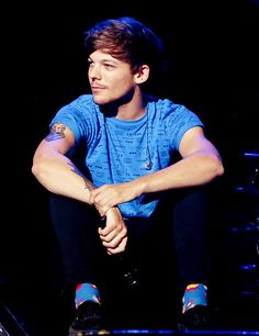 my favorite color on him HAS to be blue. but guys- HE'S WEARING SOCKS?!