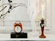 Old clock and candle