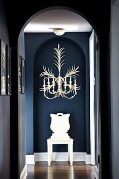 Navy walls + white palm frond candelabra sconce love the wall color