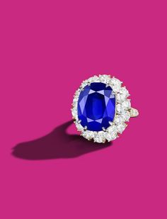A 21.30 carats Ceylon Sapphire and Diamond Cluster Ring