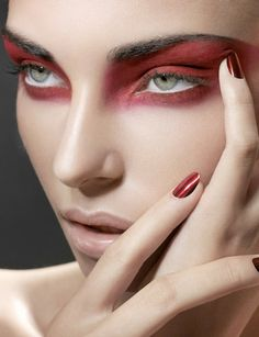 Suzana H. Red raccoon eyes. Red eyeshadow. Dramatic eye makeup