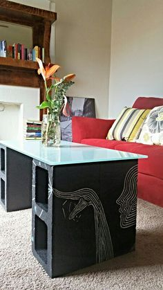 Painted cinderblock coffee table with a thrift glass top.