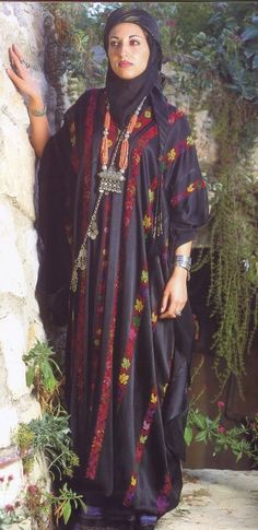 Palestine traditional dress of women. Like other parts of the Middle East, little skin is shown and women are draped in intricate fabric that is often times embellished.