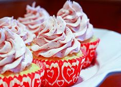 Lemon Cupcakes w/ Strawberry Meringue Buttercream.