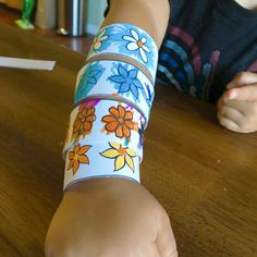 Print off these fun coloring book bracelets for your kiddos. There are 2 different designs and DiY instructions on how to put them together.