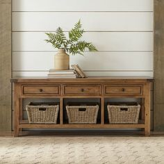 Pewter-finished metal mesh enhances the handsome craftsmanship of the Norton Console Table. Constructed with hardwood solids and cherry veneers, the table features crown molding and delicately tapered turned feet.