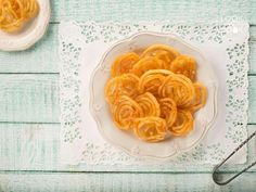 Jalebi Recipe ( Jalebis are the eternal taste of india, deep fried and soaked in sugar syrup, just the way we like them. Look and Cook this delightful dessert with us, and make your childhood dreams come true. Indian Desserts, Indian Sweets, Indian Food Recipes, Indian Foods, Indian Dishes, Cake Ingredients, Molten Chocolate, Chocolate Recipes, Deserts