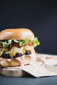 A perfectly soft bun, quality, juicy meat that is seasoned well, the BEST cheese, caramelized onions and a really, really good secret sauce is the key to a classic cheese burger.